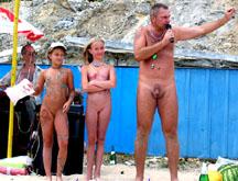 girls standing naked together